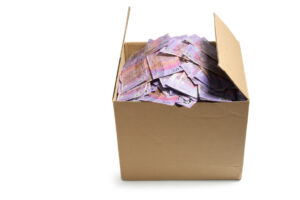 Save money when moving house box of 5 dollar Australian notes inside of moving box.