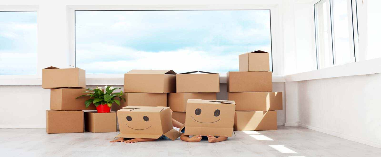 kids hiding under happy boxes
